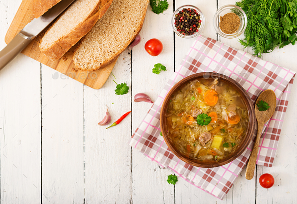 Traditional Russian soup with cabbage - sauerkraut soup. Flat lay. Top view - Stock Photo - Images