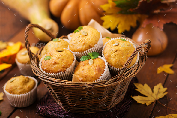 Appetizing and ruddy muffins with pumpkin and walnut. - Stock Photo - Images