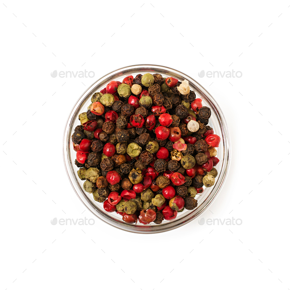Mix of pepper in a bowl isolated on a white background - Stock Photo - Images