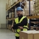 Male Warehouse Worker Standing By Pallet Truck. - VideoHive Item for Sale