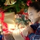 Beautiful Black Teen Girl Is Looking at Laptop, Texting To Her Friend and Smiling on Christmas Eve - VideoHive Item for Sale