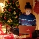 Young Black Woman Is Chatting Online Using Laptop and Sitting Near Decorated Christmas Tree - VideoHive Item for Sale