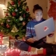 Young Woman Is Congratulating Online Her Friends Using Laptop on New Years Night - VideoHive Item for Sale