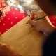 of Female Hands Writing Christmas Letter with Her Wishlist on New Years Night - VideoHive Item for Sale