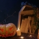 Halloween Cemetery, Candles and Jack-o-lantern