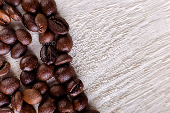 Coffee beans or grain on white wooden background. Flat lay. - Stock Photo - Images
