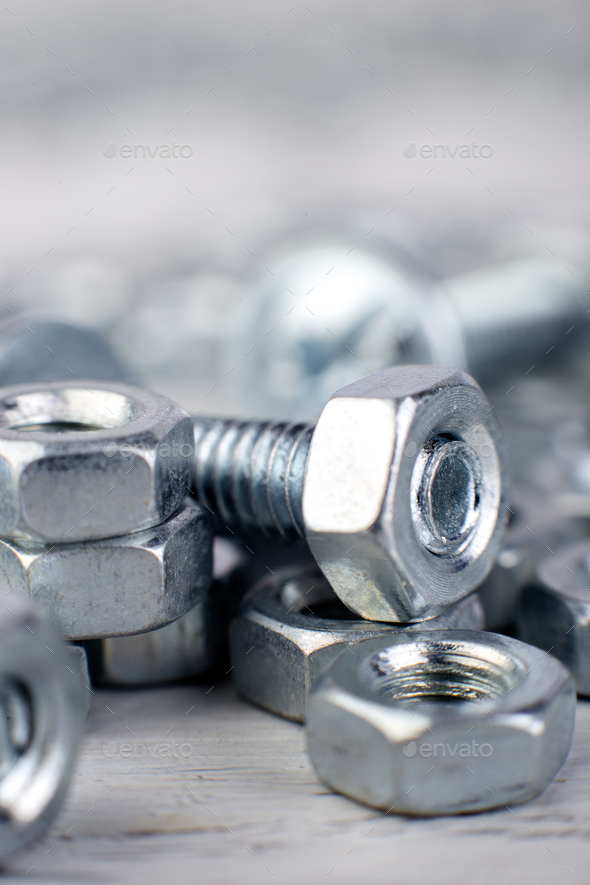 Metal nuts and bolts background. Macro. Working tools. Fixing elements. - Stock Photo - Images