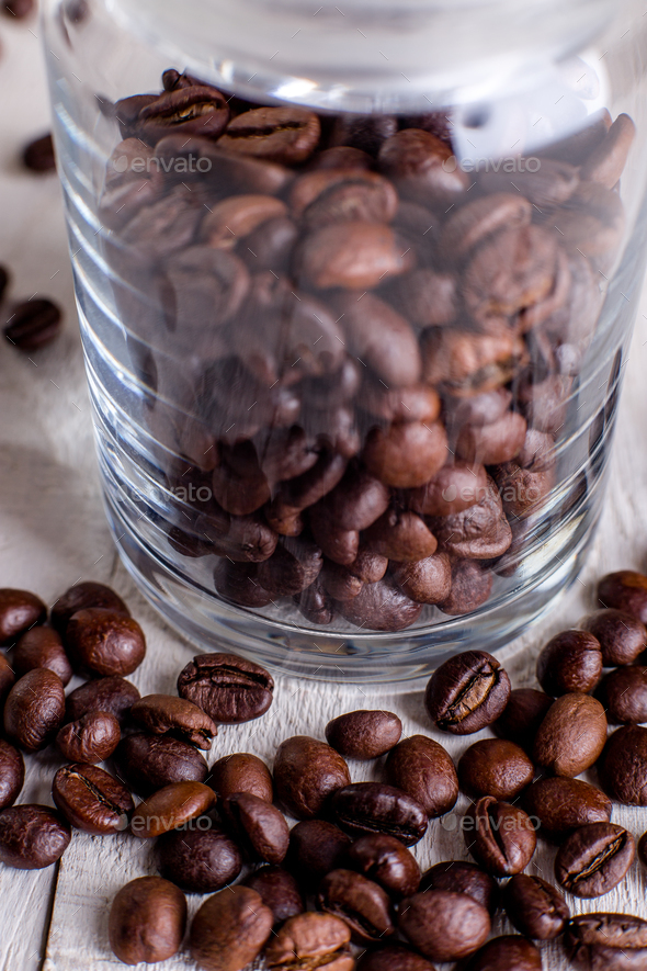 Coffee beans or grain in jar on white wooden background. - Stock Photo - Images