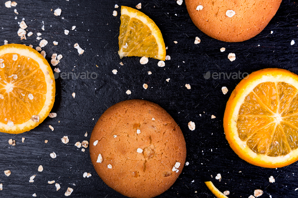 Oatmeal cookies and orange citrus fruit background. Flat lay - Stock Photo - Images