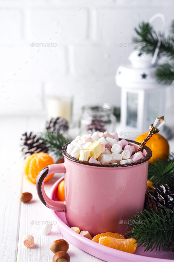 Red mug with hot chocolate with melted marshmallow - Stock Photo - Images