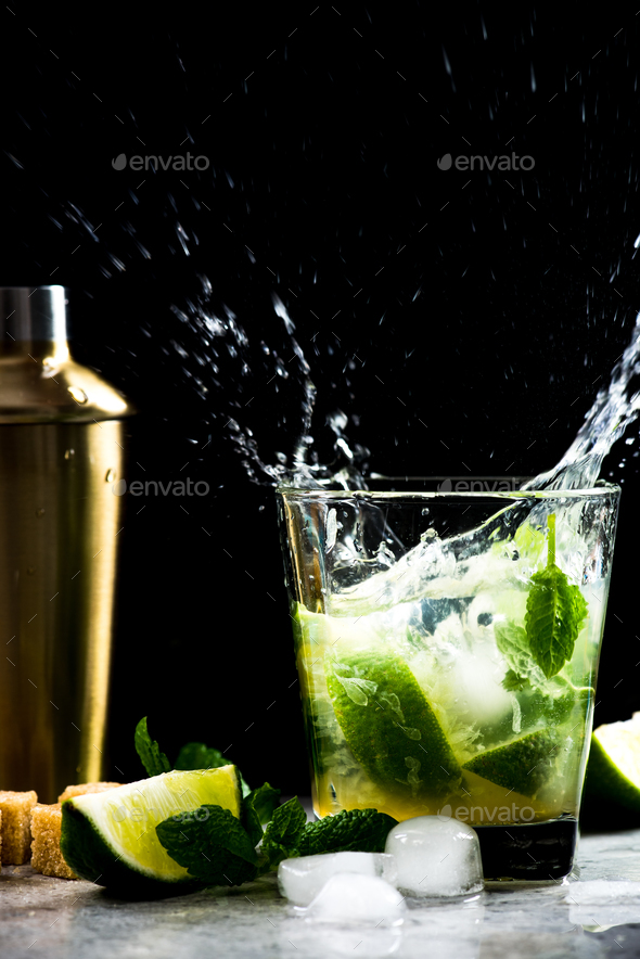 Dynamic high speed Mojito coctail splash on bar - Stock Photo - Images