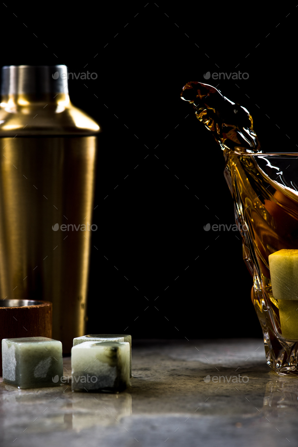 Dynamic photo of whiskey splash from glass - Stock Photo - Images