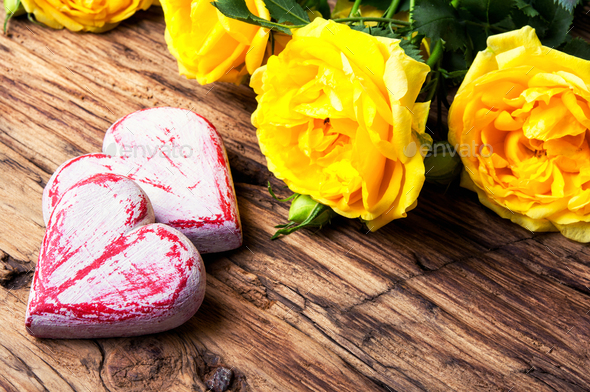 Symbolic wooden heart and flowers - Stock Photo - Images