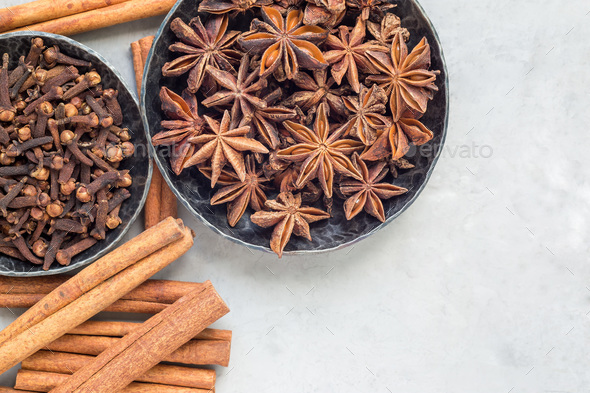 Different kinds of aromatic winter spices in bowls, top view, copy space, horizontal - Stock Photo - Images