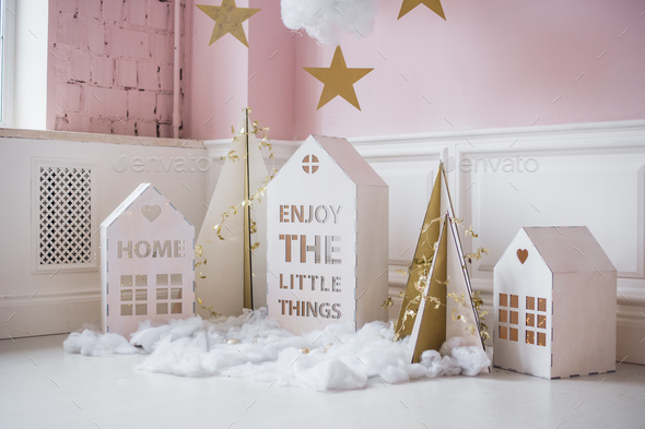 Small christmas houses decoration and stars hanging - Stock Photo - Images