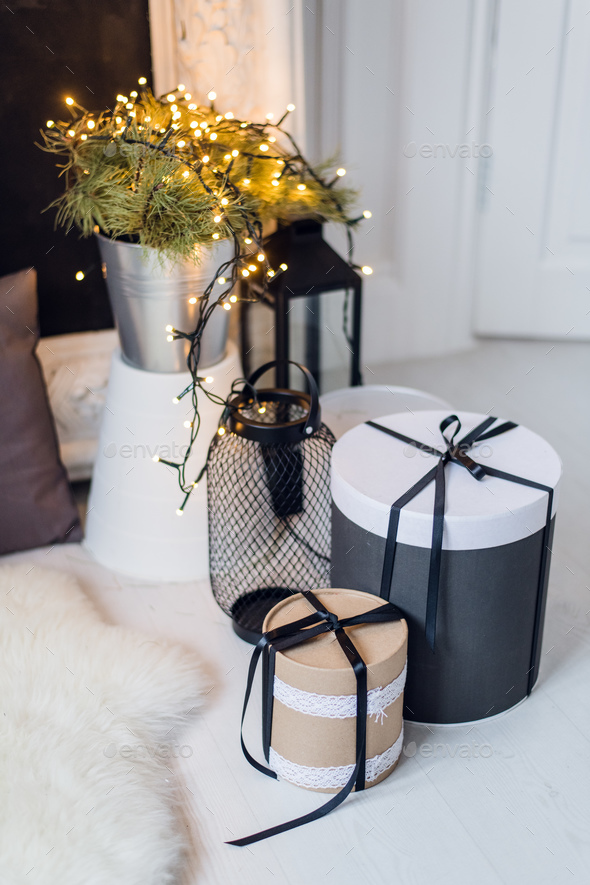 Cylinder gift boxes, cosy christmas decoration, flowers bucket on a background - Stock Photo - Images