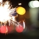 Burning Sparkler On Bokeh Light Background - VideoHive Item for Sale