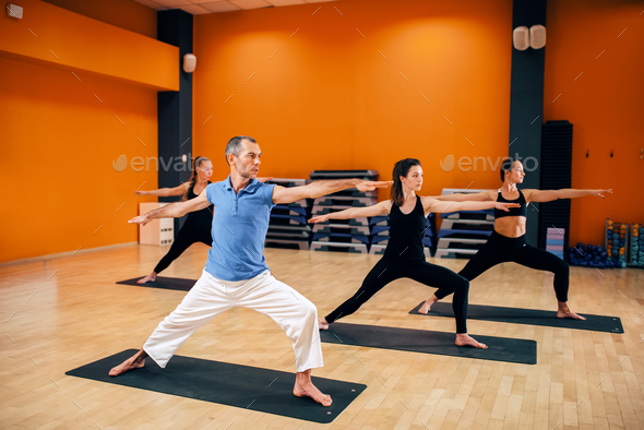 Yoga training, female group with trainer in action - Stock Photo - Images