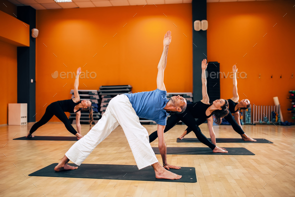 Yoga training, female group with trainer in motion - Stock Photo - Images