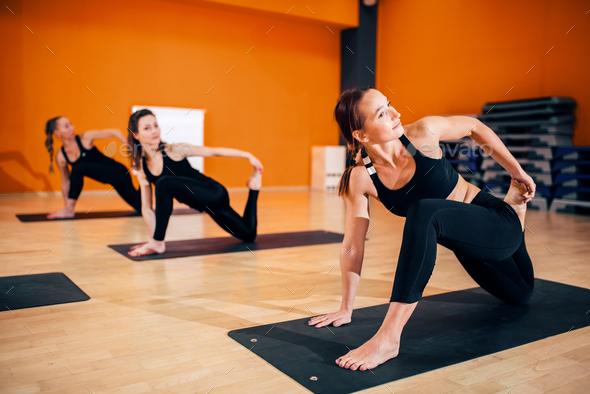 Female yoga group, training with instructor - Stock Photo - Images
