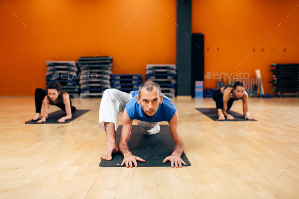Female yoga group, training with instructor - Stock Photo - Images