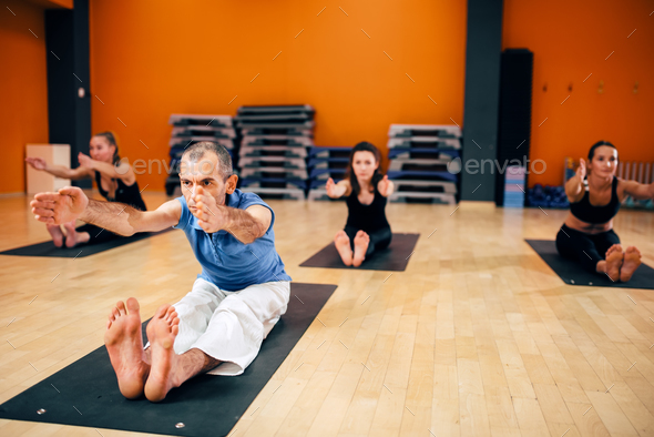 Yoga, female group with instructor in motion - Stock Photo - Images