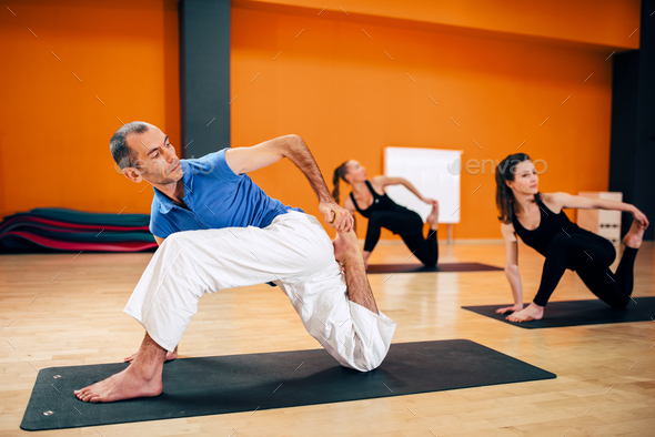 Stretching exercise, female yoga group in action - Stock Photo - Images