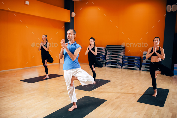 Balance exercise, female yoga group in action - Stock Photo - Images