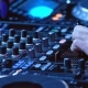 DJ Plays Mix on Controller at a Disco - VideoHive Item for Sale
