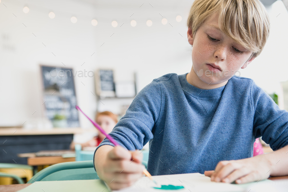Boy Painting in Class - Stock Photo - Images