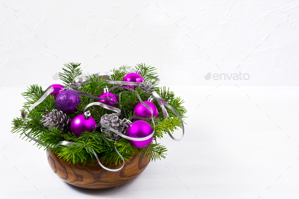 Christmas centerpiece with glitter and purple baubles, copy spac - Stock Photo - Images