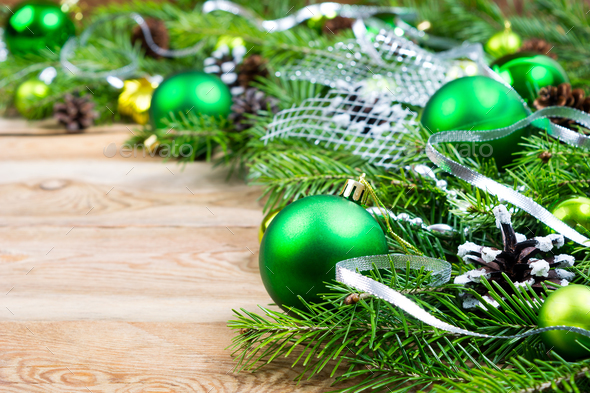 Christmas background with green baubles and silver ribbon - Stock Photo - Images