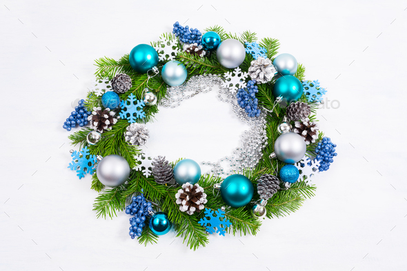 Christmas silver, blue, turquoise balls and pine cones wreath - Stock Photo - Images