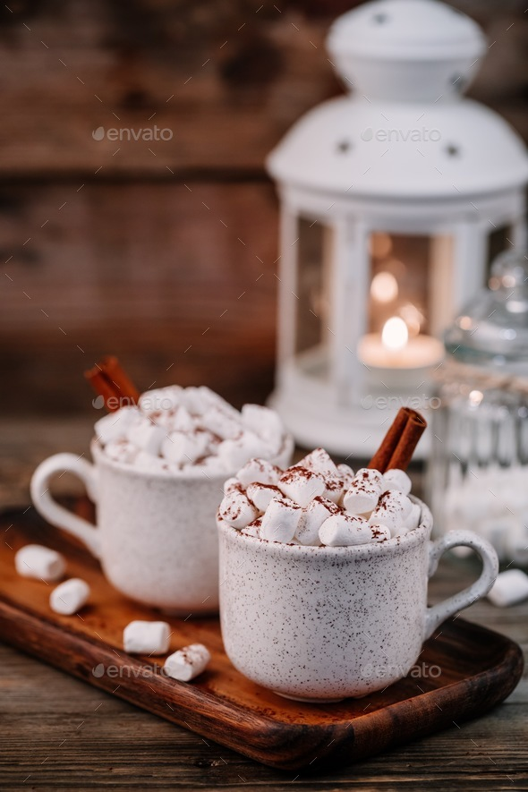 Christmas drink. Hot chocolate with marshmallows and cinnamon on dark wooden background. - Stock Photo - Images