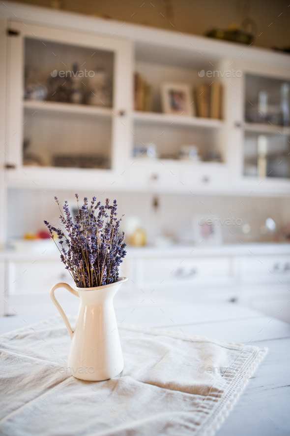 Dried lavender bunch in a white vase in vintage kitchen. - Stock Photo - Images