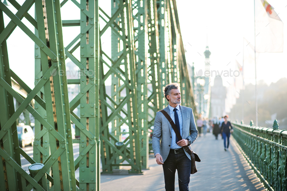 Mature businessman in a city. - Stock Photo - Images