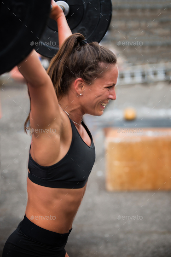 Woman lifting weights - Stock Photo - Images
