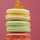 Stack of Colorful Rotating Macaroons on Color Background - VideoHive Item for Sale