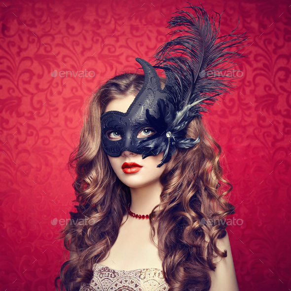 Beautiful young woman in black mysterious  Venetian mask - Stock Photo - Images