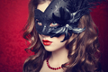 Beautiful young woman in black mysterious  Venetian mask - PhotoDune Item for Sale