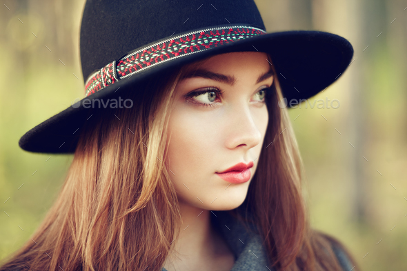 Portrait of young beautiful woman in autumn coat - Stock Photo - Images