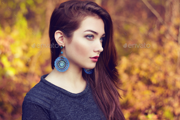 Portrait of young beautiful woman in autumn park - Stock Photo - Images