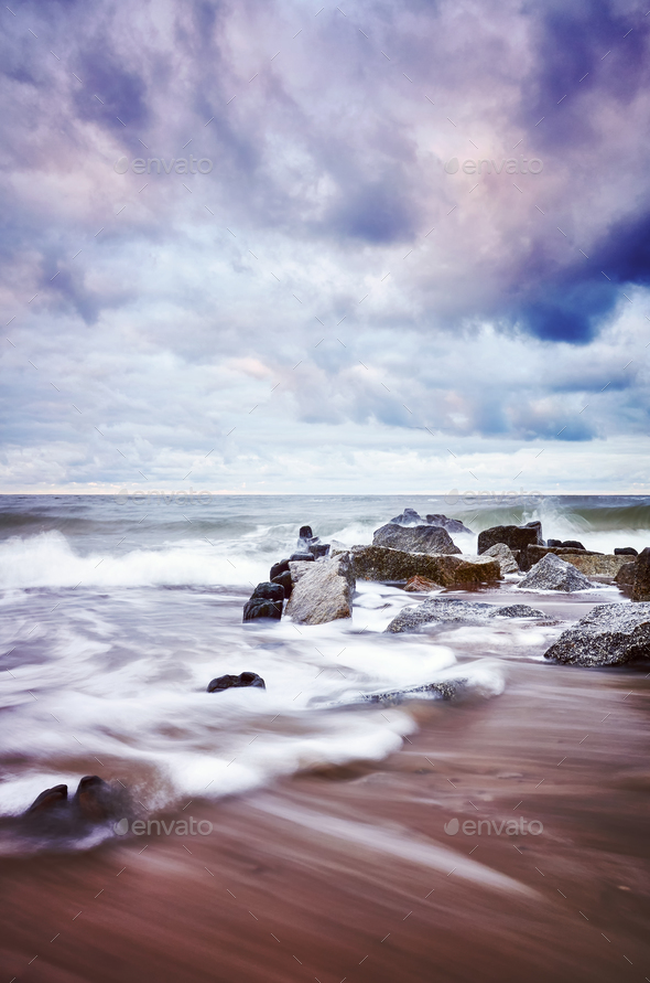 Color toned picture of an empty beach with blurred water. - Stock Photo - Images