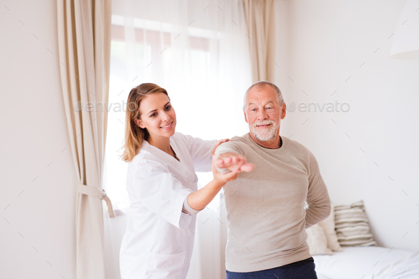 Health visitor and senior man during home visit. - Stock Photo - Images