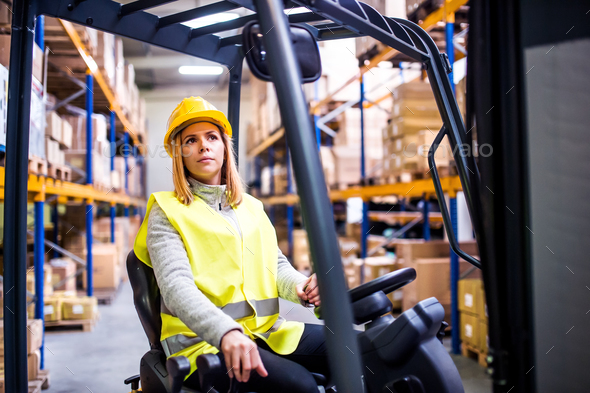 Woman warehouse worker with forklift. - Stock Photo - Images