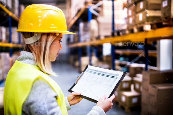 Young woman warehouse worker. - Stock Photo - Images