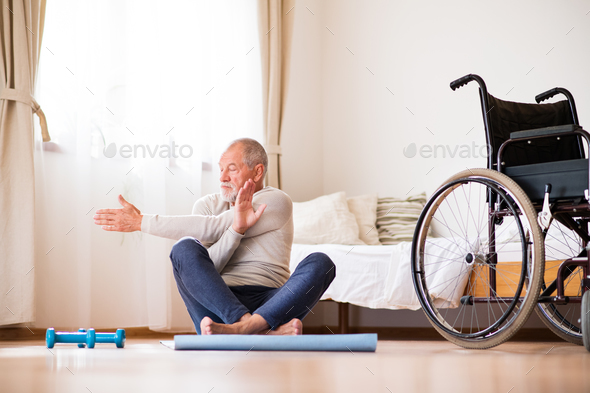 Senior man doing exercise at home. - Stock Photo - Images