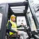 Woman forklift truck driver in an industrial area. - PhotoDune Item for Sale
