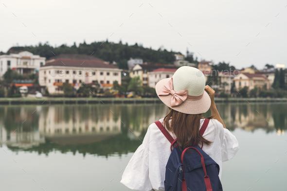 Young asian traveler with backpack at Sapa lake, Vietnam - Stock Photo - Images