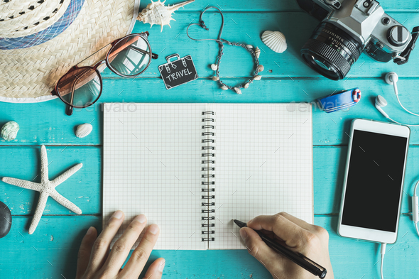 Overhead view of Traveler's accessories and items with notebook - Stock Photo - Images